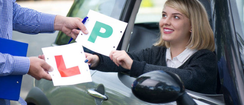 The Driving Test - Learner Driver Swapping Her L Plate for a P Plate